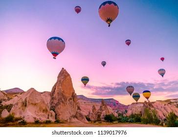 Kapadokya Beautiful vibrant colorful balloons in sunrise light in Cappadocia Turkey Goreme