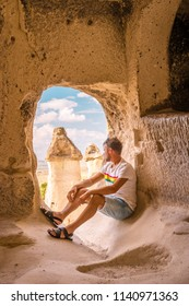 Kapadokya Turkey, Man looking into the distance against the background of incredible landscape with mountains , geological structures in Goreme, Cappadocia, Turkey