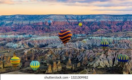 Kapadokya, Turkey - March 23 2014: Early sun rise Kapadokya hot air ballon tour in the red valley with fary chimneys