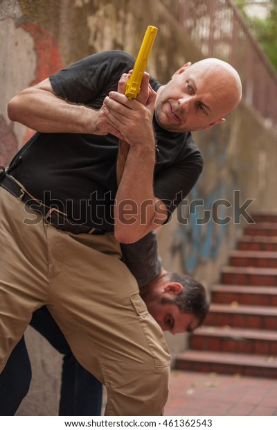 Kapap instructor demonstrates self defense techniques against a gun
