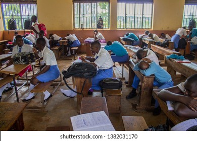 Kapeka, Uganda, October 20 2018: visitation day at a boarding secondary school in the pearl of Africa. Unidentified boys and girls sleeping in classrooms in boaring boarding circumstances studying.