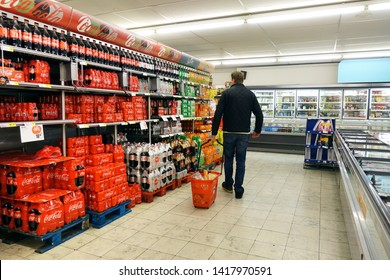 KAPELLEN, BELGIUM - MARCH 23, 2019: Aisle containing exclusive Coca-Cola Company products in a belgian Delhaize supermarket.