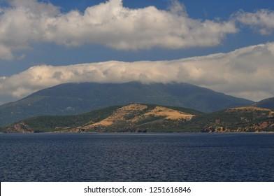 Kapidagi peninsula with sky clouds background. Balikesir, Turkey.