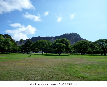 Kapiolani Park during day with Diamond Head and clouds in the distance on Oahu, Hawaii.