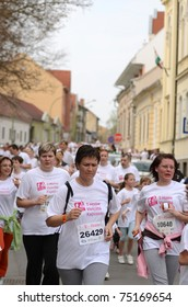 KAPOSVAR, HUNGARY - APRIL 3: Unidentified runners at the T-Home Vivicitta Running Race on April 3, 2011 in Kaposvar, Hungary.