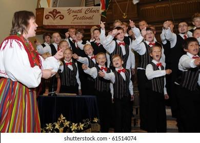 KAPOSVAR, HUNGARY - AUGUST 26: Members of the Suae Music School Choir (EST) sing at the IV. Pannonia Cantat Youth Choir Festival August 26, 2010 in Kaposvar, Hungary