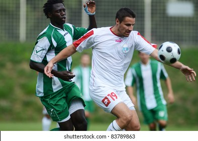 KAPOSVAR, HUNGARY - AUGUST 27: Haruna Jammeh (in green) in action at a Hungarian National Championship III. soccer game Kaposvar (green) vs. Szentlorinc (white) August 27, 2011 in Kaposvar, Hungary.
