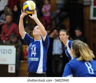 KAPOSVAR, HUNGARY - DECEMBER 17: Dora Ihasz (14) posts the ball at the Hungarian Extra League woman volleyball game between Kaposvar and Miskolc , December 17, 2008 in Kaposvar, Hungary.