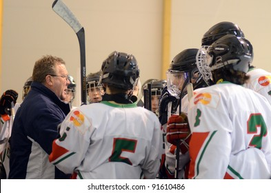 KAPOSVAR, HUNGARY - DECEMBER 17: Hungarian players listening to trainer at a friendly ice hockey match with Hungarian (w) and Italian (b) U16 National Team, December 17, 2011 in Kaposvar, Hungary.