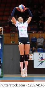 KAPOSVAR, HUNGARY – DECEMBER 2, 2018: Kristina Cesljar (in white) in action at a Hungarian National Championship volleyball game between Kaposvar (white) and Palota VSN (blue) in Sportcsarnok Kaposvar