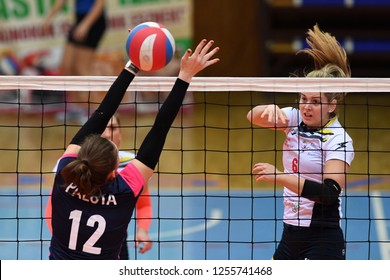 KAPOSVAR, HUNGARY – DECEMBER 2, 2018: Evelin Vacsi (white 6) in action at a Hungarian National Championship volleyball game between Kaposvar (white) and Palota VSN (blue) in Sportcsarnok Kaposvar.