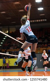 KAPOSVAR, HUNGARY – DECEMBER 2, 2018: Norina Csaszar strikes ball at a Hungarian National Championship volleyball game between Kaposvar (white) and Palota VSN (blue) in Sportcsarnok Kaposvar.