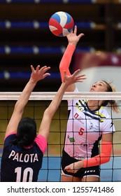 KAPOSVAR, HUNGARY – DECEMBER 2, 2018: Nevena Iricanin (white 5) in action at a Hungarian National Championship volleyball game between Kaposvar (white) and Palota VSN (blue) in Sportcsarnok Kaposvar.