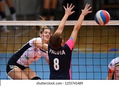 KAPOSVAR, HUNGARY – DECEMBER 2, 2018: Evelin Vacsi (in white) in action at a Hungarian National Championship volleyball game between Kaposvar (white) and Palota VSN (blue) in Sportcsarnok Kaposvar.
