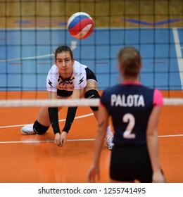 KAPOSVAR, HUNGARY – DECEMBER 2, 2018: Sara Heri (white 8) in action at a Hungarian National Championship volleyball game between Kaposvar (white) and Palota VSN (blue) in Sportcsarnok Kaposvar.