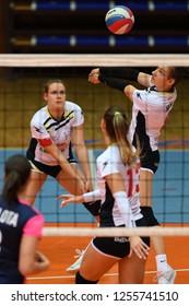 KAPOSVAR, HUNGARY – DECEMBER 2, 2018: Sara Heri receives ball at a Hungarian National Championship volleyball game between Kaposvar (white) and Palota VSN (blue) in Sportcsarnok Kaposvar.