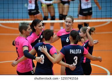 KAPOSVAR, HUNGARY – DECEMBER 2, 2018: Palota players celebrate at a Hungarian National Championship volleyball game between Kaposvar (white) and Palota VSN (blue) in Sportcsarnok Kaposvar.