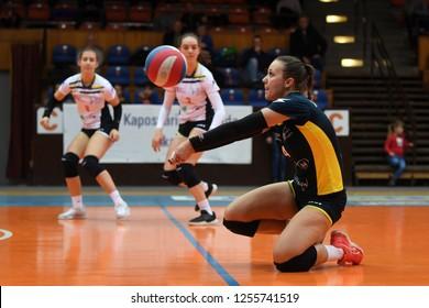 KAPOSVAR, HUNGARY – DECEMBER 2, 2018: Dorottya Kanizsai receives ball at a Hungarian National Championship volleyball game between Kaposvar (white) and Palota VSN (blue) in Sportcsarnok Kaposvar.