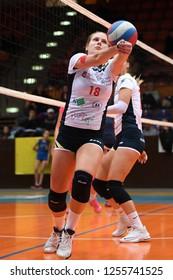 KAPOSVAR, HUNGARY – DECEMBER 2, 2018: Norina Csaszar (with ball) in action at a Hungarian National Championship volleyball game between Kaposvar (white) and Palota VSN (blue) in Sportcsarnok Kaposvar.