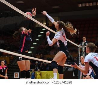 KAPOSVAR, HUNGARY – DECEMBER 2, 2018: Zsofia Harmath (white 13) in action at a Hungarian National Championship volleyball game between Kaposvar (white) and Palota VSN (blue) in Sportcsarnok Kaposvar.