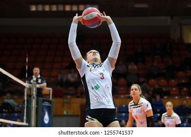 KAPOSVAR, HUNGARY – DECEMBER 2, 2018: Viktoria Kalmar posts ball at a Hungarian National Championship volleyball game between Kaposvar (white) and Palota VSN (blue) in Sportcsarnok Kaposvar.