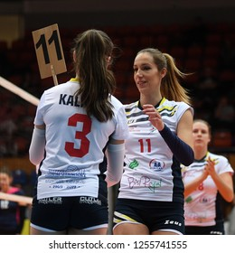 KAPOSVAR, HUNGARY – DECEMBER 2, 2018: Kristina Cesljar comes down from field at a Hungarian National Championship volleyball game between Kaposvar (white) and Palota (blue) in Sportcsarnok Kaposvar.