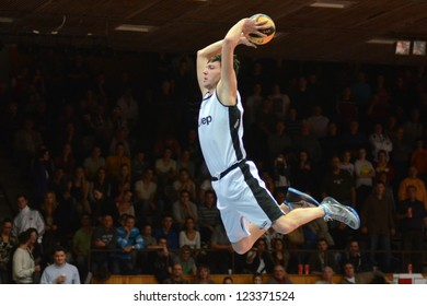 KAPOSVAR, HUNGARY - DECEMBER 22: An unidentified player in action at FACE TEAM Acrobatic Basketball Show, December 22, 2012 in Kaposvar, Hungary