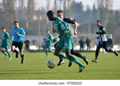 KAPOSVAR, HUNGARY - FEBRUARY 22: Bebeto (in green) in action at a Hungarian National Cup soccer game Kaposvar (green) vs Papa (white) February 22, 2012 in Kaposvar, Hungary.