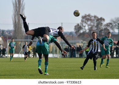 KAPOSVAR, HUNGARY - FEBRUARY 22: Unidentified players in action at a Hungarian National Cup soccer game Kaposvar (green) vs Papa (white) February 22, 2012 in Kaposvar, Hungary.