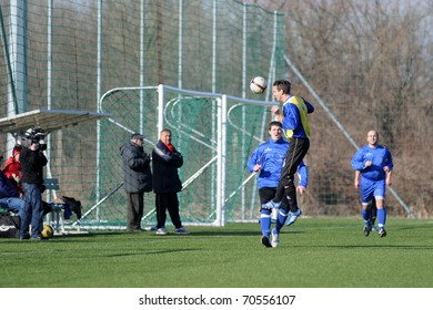 KAPOSVAR, HUNGARY - FEBRUARY 5: Unidentified players in action at a friendly soccer game Nagybajom vs. Balatonlelle (CRO) - February 5, 2011 in Kaposvar, Hungary.