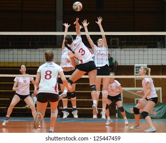 KAPOSVAR, HUNGARY - JANUARY 13: Zsofia Harmath 3) in action at the Hungarian I. League volleyball game Kaposvar (white) vs Budapest SE (white), January 13, 2013 in Kaposvar, Hungary.