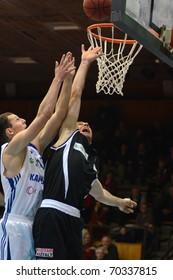 KAPOSVAR, HUNGARY - JANUARY 30: Mate Medve (L) in action at a Hungarian National Championship basketball game Kaposvar vs Pecs on January 30, 2011 in Kaposvar, Hungary.