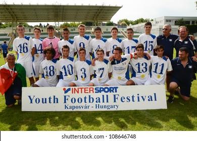 KAPOSVAR, HUNGARY - JULY 21: Brescia players celebrate at the VIII. Youth Football Festival U17 Final SYFA W.R.  (yellow)(SCO) vs. Brescia Academy (white) (ITA) July 21, 2012 in Kaposvar, Hungary