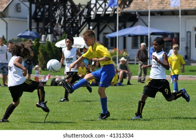 KAPOSVAR, HUNGARY - JULY 21: Unidentified players in action at the V. Youth Football Festival match on July 21, 2009 in Kaposvar, Hungary.