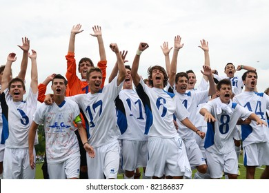 KAPOSVAR, HUNGARY - JULY 23: Brescia players celebrate win at the VII. Youth Football Festival Under 16 Final Luneburg (red)(GER) vs. Brescia Academy (white) (ITA) July 23, 2011 in Kaposvar, Hungary