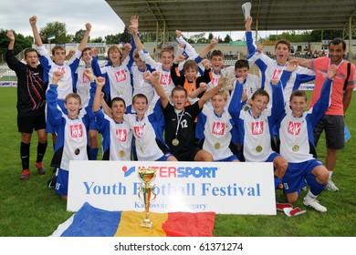 KAPOSVAR, HUNGARY - JULY 24: Romanian players celebrates the win at the VI. Youth Football Festival Under 14 Final Banatul Timisoara (ROM) vs NK Granicar (CRO) July 24, 2010 in Kaposvar, Hungary