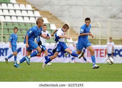 KAPOSVAR, HUNGARY - JULY 24: Unidentified players in action at the VI. Youth Football Festival Under 14 Final Banatul Timisoara (ROM) vs NK Granicar (CRO) July 24, 2010 in Kaposvar, Hungary