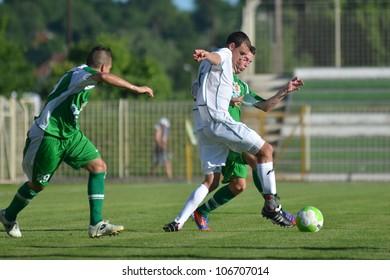 KAPOSVAR, HUNGARY - JUNE 16: Unidentified players in action at the Hungarian National Championship under 19 game Kaposvar (white) vs. Paks (green) on June 16, 2012 in Kaposvar, Hungary.