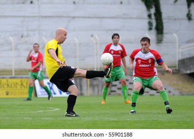 KAPOSVAR,  HUNGARY - JUNE 19: Unidentified players in action at a Somogy County Championship II. final game Labod vs. Sagvar - June 19, 2010 in Kaposvar, Hungary.