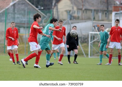 KAPOSVAR, HUNGARY - MARCH 13: Zsolt Arvai (3rd from L) in action at the Hungarian National Championship under 17 game between Kaposvar and Mohacs on March 13, 2011 in Kaposvar, Hungary.
