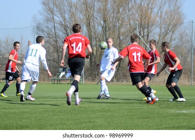 KAPOSVAR, HUNGARY - MARCH 16: Unidentified players in action at the Hungarian National Championship under 19 game between Kaposvar (white) and Szentlorinc (red) on March 16, 2012 in Kaposvar, Hungary.