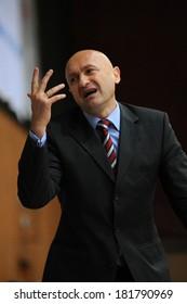 KAPOSVAR, HUNGARY - MARCH 8: Branislav Dzunic (Paks trainer) in action at a Hungarian Championship basketball game with Kaposvar (white) vs. Paks (red) on March 8, 2014 in Kaposvar, Hungary.