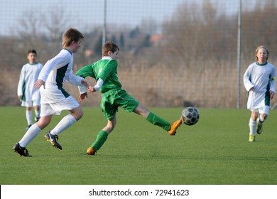 KAPOSVAR, HUNGARY - MARCH 9: Attila Berki (in green) in action at the Hungarian National Championship under 13 game between Kaposvar and Airnergy FC on March 9, 2011 in Kaposvar, Hungary.
