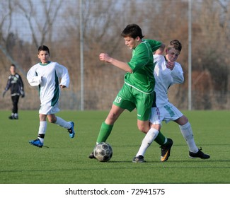 KAPOSVAR, HUNGARY - MARCH 9: Peter Molnar (in green) in action at the Hungarian National Championship under 13 game between Kaposvar and Airnergy FC on March 9, 2011 in Kaposvar, Hungary.