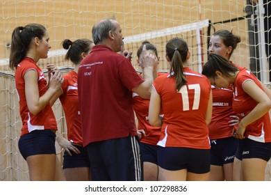 KAPOSVAR, HUNGARY - MAY 18: Budai XI players listening to trainer at the final of the hungarian junior volleyball championship (Kaposvar  blue vs. Budai XI  red) , May 18, 2012 in Kaposvar, Hungary