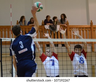 KAPOSVAR, HUNGARY - MAY 18: Unidentified players in action at the final of the hungarian junior volleyball championship (Szolnok white vs. Kazincbarcika  blue) , May 18, 2012 in Kaposvar, Hungary