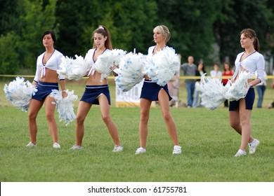 KAPOSVAR, HUNGARY - MAY 20: Cheerleaders perform at an American football game Goldenfox vs. Budapest Cowboys, May 20, 2007 in Kaposvar, Hungary.