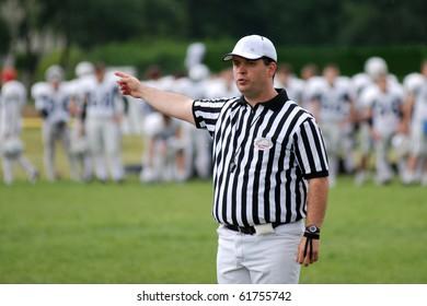 KAPOSVAR, HUNGARY - MAY 20: A referee in action an American football game Goldenfox vs. Budapest Cowboys, May 20, 2007 in Kaposvar, Hungary.