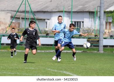 KAPOSVAR, HUNGARY - MAY 22: Soma Ozorai (2nd from L) in action at the Hungarian National Championship under 13 game between Kaposvari Rakoczi and Kozarmisleny May 22, 2010 in Kaposvar, Hungary.