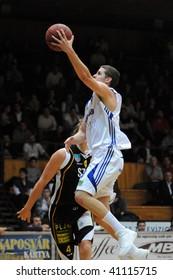 KAPOSVAR, HUNGARY - NOVEMBER 13: Vojvoda (in white) in action at Hungarian National Championship basketball game Kaposvar vs Szombathely November 13, 2009 in Kaposvar.